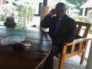 Rev.Bwayo trying the aids